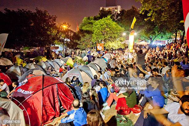 CONTENT] Protesters their tents and visitors at Gezi park Taksim Istanbul