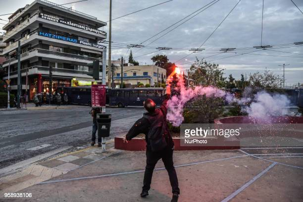 Protesters throw a flare at the Israeli embassy during a demonstration in central Athens on May 15 2018 against the bloodshed along the Gaza border...