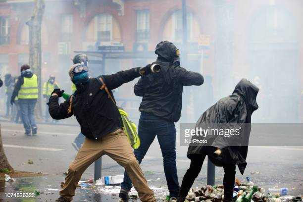 Protesters throw bottles to riot police Act VI dubbed 'Revolt' of the Yellow Vest movement begun peacefully but the protest turned rapidly to riots...