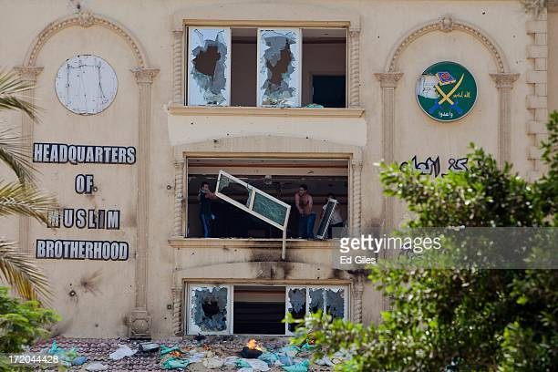 Protesters throw furniture from the windows of the headquarters of Egypt's Muslim Brotherhood as they ransack the building in the suburb of Muqattam...