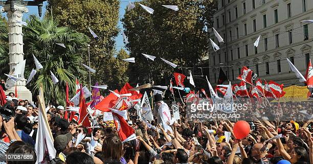 Protesters throw paper planes in front of the Italian ministry of education during a demonstration to protest against the government's education...