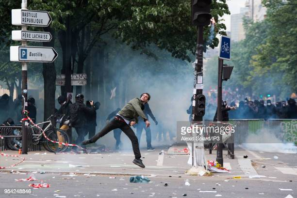 Protesters throw projectiles at CRS on the sidelines of the May 1st demonstration on May 1 2018 in Paris France Several hundred protesters defied the...
