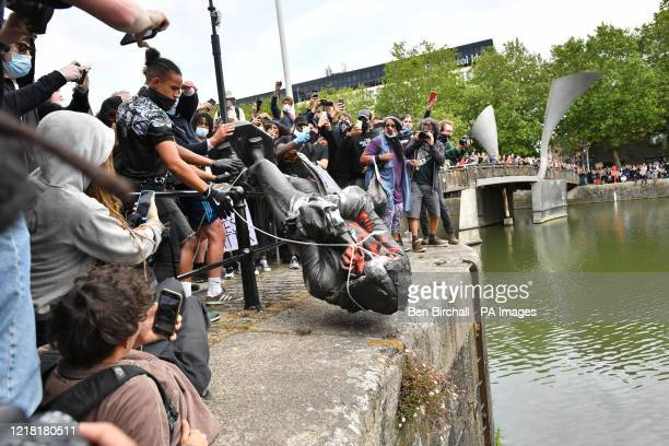 Protesters throw statue of Edward Colston into Bristol harbour during a Black Lives Matter protest rally in memory of George Floyd who was killed on...