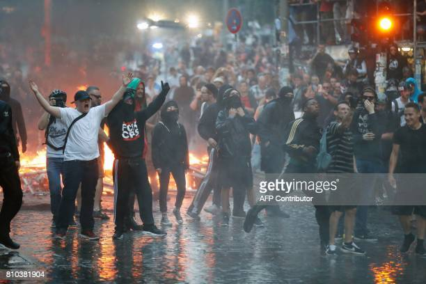 Protesters throw stones at riot police on July 7 2017 in Hamburg northern Germany where leaders of the world's top economies gather for a G20 summit...