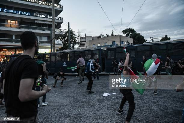 Protesters throw stones at the Israeli embassy during a demonstration in central Athens on May 15 2018 against the bloodshed along the Gaza border...