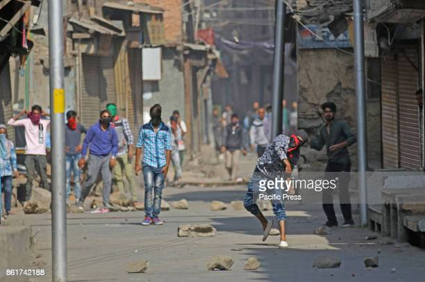 Protesters throwing stones towards police men in Habba Kadal soon after mysterious braid chopping incident happen in the area more then100 braid...