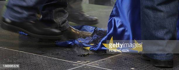 Protesters trample a burnt European Union flag during a demonstration untitled 'To be members or to be free' and called by the rightwing...