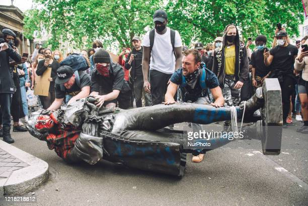 Protesters transporting the statue of Colston towards the river Avon. Edward Colston was a slave trader of the late 17th century who played a major...