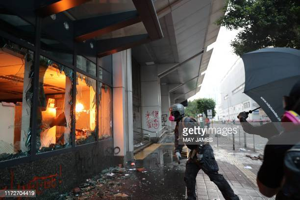 TOPSHOT Protesters trash a local government office during a demonstration in the Sham Shui Po area in Hong Kong on October 1 as the city observes the...