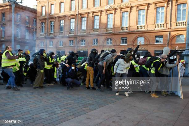 Protesters try to protect themselves behind a banner Act XIII dubbed 'Civil disobediencequot' of the Yellow Vest movement begun peacefully but the...