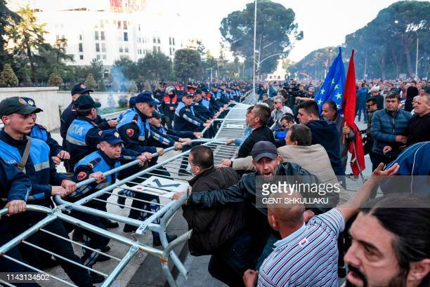 Protesters try to remove a metal fence outside the Government building during an anti-government protest called by the opposition on May 11, 2019 in...