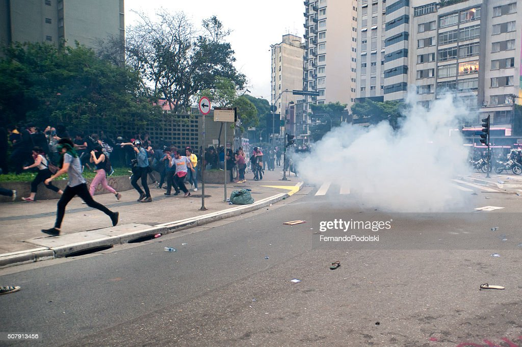 Protesters Under Attack : Stock Photo