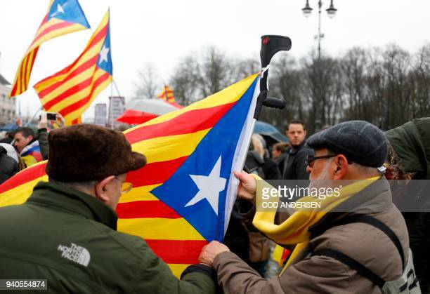 Protesters use a crutch to wave the Catalan flag 'Estelada' while taking part in a demonstration organized by the proindependence association ANC to...