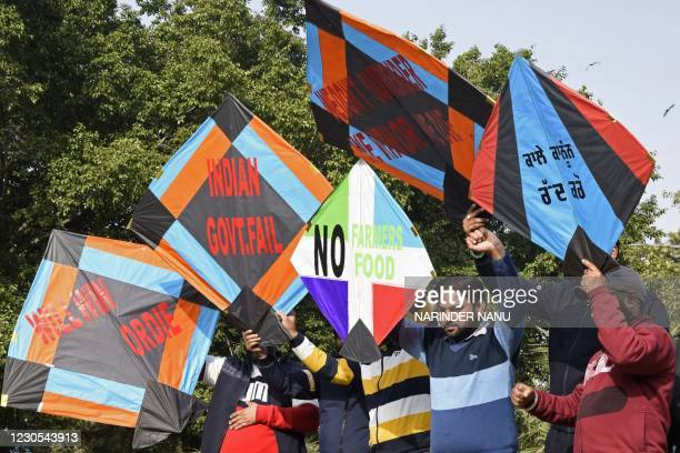 Protesters use kites as placards during a demonstration in support of farmers protesting against the central government's recent agricultural reforms...