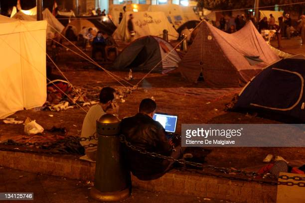 Protesters view internet with a laptop on Tahrir Square on November 26 2011 in Cairo Egypt Thousands of Egyptians are continuing to occupy Tahrir...