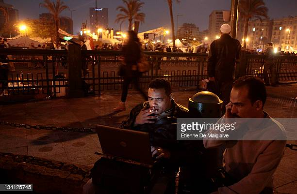 Protesters view the internet with a laptop on Tahrir Square on November 26 2011 in Cairo Egypt Thousands of Egyptians are continuing to occupy Tahrir...