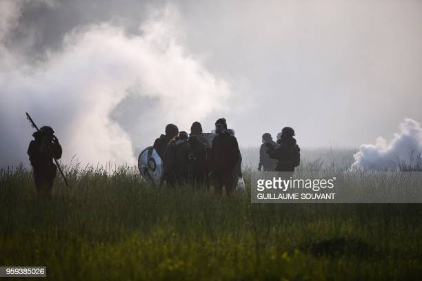 TOPSHOT Protesters wait in a field for French gendarmes during a second eviction of environmental protesters from the area known as ZAD in...