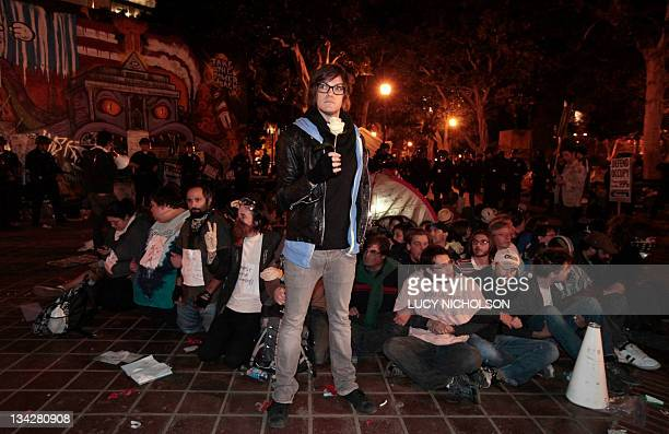 Protesters wait to be arrested at the Occupy Los Angeles encampment outside City Hall on November 30 2011 Hundreds of riot police flooded into...