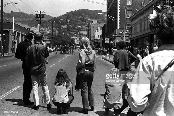Protesters wait to see if the police will retaliate after rioting over People's Park on May 15 1969 in Berkeley California