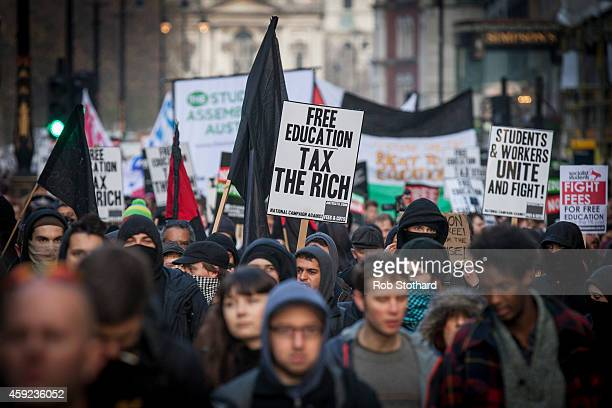 Protesters walk down The Strand during a march against student university fees on November 19 2014 in London England A coalition of student groups...