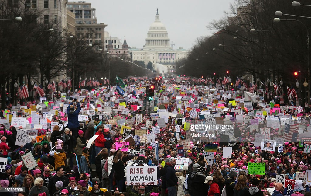 Protesters walk during the Women's March on Washington, with the U.S. Capitol in the background, on January 21, 2017 in Washington, DC. Large crowds are attending the anti-Trump rally a day after U.S. President Donald Trump was sworn in as the 45th U.S. president.