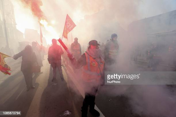 Protesters walk in the streets of Versailles outside Paris on January 21 during a rally called by the General Confederation of Labour trade union...