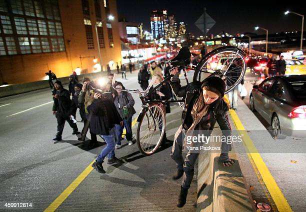 Protesters walk on the West Side Highway December 3 2014 in New York Protests began after a Grand Jury decided to not indict officer Daniel Pantaleo...