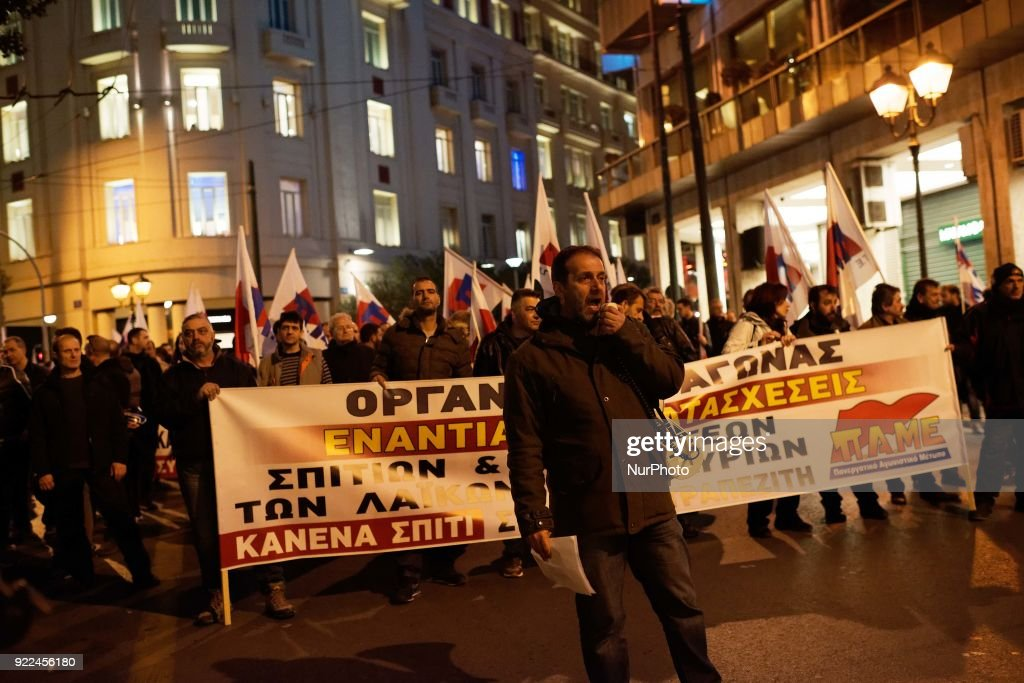 "Protesters walk past a banner depicting a Greek Ancient sculpture reading ""Take a memory of Greece"" during a demonstration against online auctions of foreclosed properties in Athens, Greece on February 21, 2018. A rally against online auctions of foreclosed properties was held in central Athens by labor unions affiliated to the Greek Communist Party (KKE)."