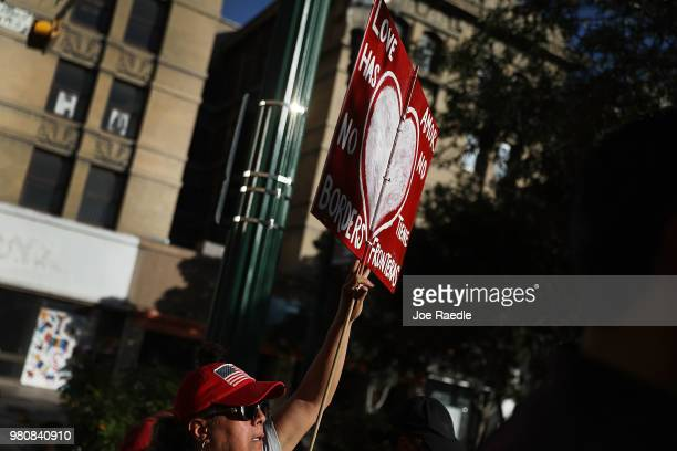 Protesters walk though the streets as they protest against the Trump administration's immigration policies on June 21 2018 in El Paso Texas Before...