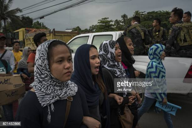 Protesters walking a street in Iligan city after being prevented by police to hold a program against martial law on July 24, 2017 in Iligan city,...