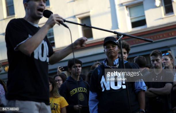 Protesters watch political activists speak during a demonstration outside of Zellerbach Hall on the UC Berkeley campus on September 14 2017 in...