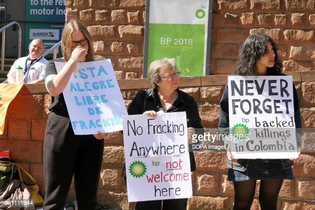 Protesters watched by a security guard stage a Demonstration against BP outside its Annual General Meeting to highlight the companies environmental...
