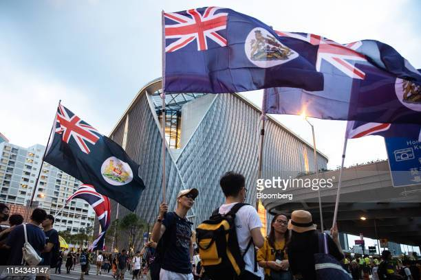 Protesters wave British colonial flags outside West Kowloon Station during a protest in Hong Kong China on Sunday July 7 2019 The Hong Kong...