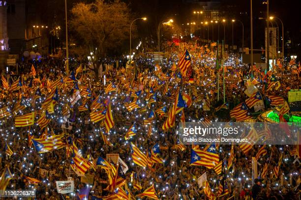 Protesters wave Catalan Independence flags during a demonstration titled 'Self-determination is not a crime' at Cibeles Square on March 16, 2019 in...