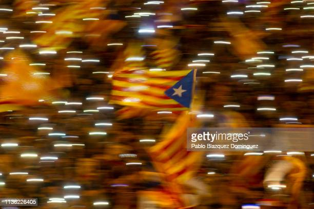 Protesters wave Catalan Independence flags during a demonstration titled 'Selfdetermination is not a crime' at Cibeles Square on March 16 2019 in...