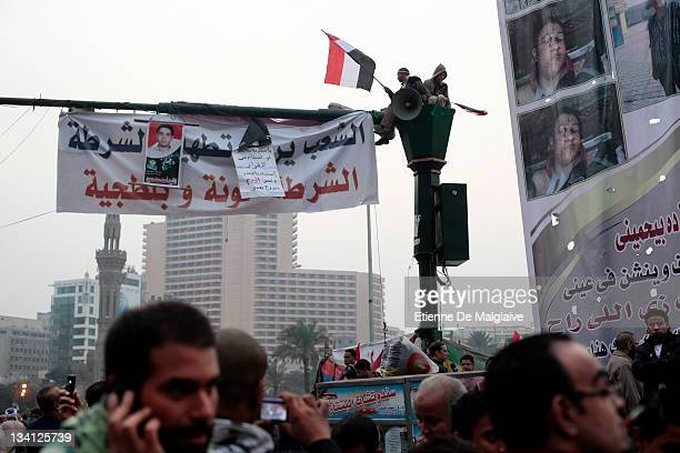 Protesters wave Egyptian flags on Tahrir Square on November 26 2011 in Cairo Egypt Thousands of Egyptians are continuing to occupy Tahrir Square...