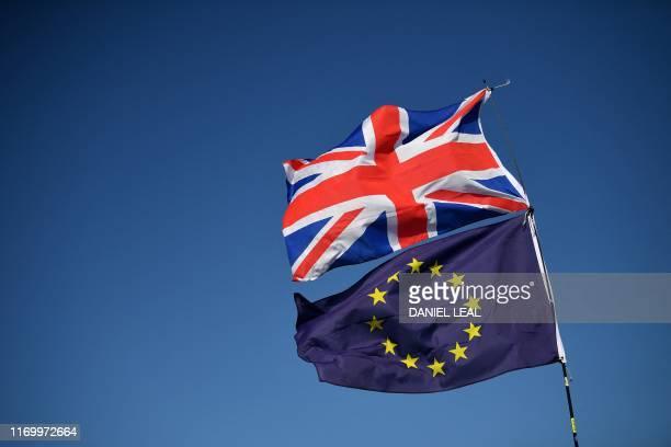 TOPSHOT Protesters wave EU and Union flags as they gather for a march and rally organised by The People's Vote in Brighton on the south coast of...