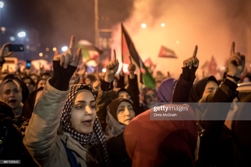 Protesters wave flags and shout slogans outside the U.S. Consulate on December 6, 2017 in Istanbul, Turkey. People gathered to protest after U.S President Donald Trump declared recognition of Jerusalem as the capital of Israel. President Trump went ahead with the announcement despite warnings from Middle East leaders and the Pope condemning the decision. The announcement which breaks decades of U.S. policy threatens to bring further instability to the region.