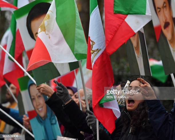 Protesters wave flags as they gather outside the Iranian Embassy in central London on January 2 in support of national demonstrations in Iran against...