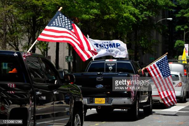 Protesters wave flags during a reopen Virginia rally around Capitol Square in Richmond on April 22 2020 Protesters were opposed to the stayathome...