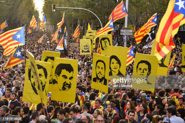 Protesters wave flags in the street as a general strike is called following a week of protests over the jail sentences given to separatist...