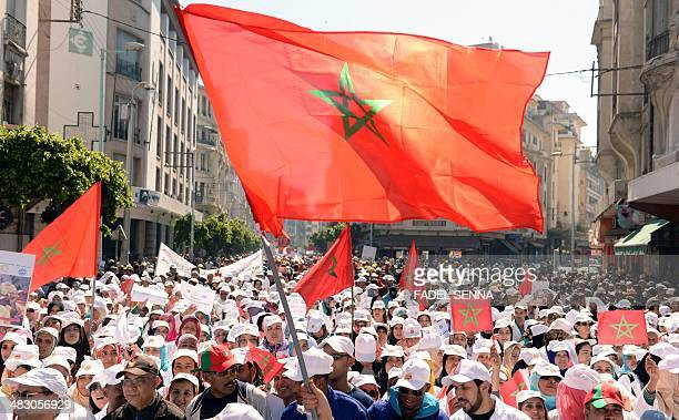 Protesters wave national flags during a demonstration gathering workers teachers and civil servants against the deterioration in the social and...