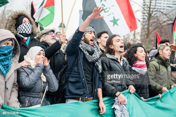 Protesters wave Palestinian flags and shout slogans during a demonstration against US President Donald Trump's recognition of Jerusalem as Israel's...