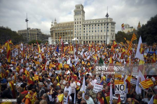 Protesters wave Spanish and Catalan flags during a demonstration called by Catalan Civil Society under the motto 'Catalonia yes Spain too' in...