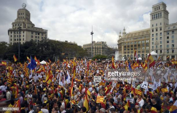 TOPSHOT Protesters wave Spanish and Catalan flags during a demonstration called by Catalan Civil Society under the motto 'Catalonia yes Spain too' in...