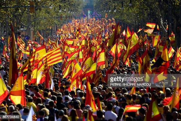 TOPSHOT Protesters wave Spanish and Catalan Senyera flags during a prounity demonstration in Barcelona on October 29 2017 Prounity protesters were to...
