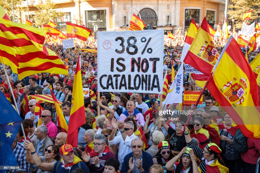 Protesters wave Spanish flags and carry banners during a pro-unity demonstration on October 29, 2017 in Barcelona, Spain. Thousands of pro-unity protesters gather in Barcelona, two days after the Catalan Parliament voted to split from Spain. The Spanish government has responded by imposing direct rule and dissolving the Catalan parliament.