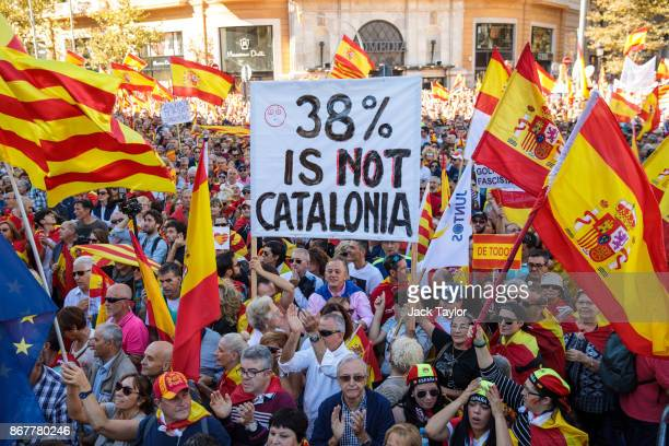 Protesters wave Spanish flags and carry banners during a prounity demonstration on October 29 2017 in Barcelona Spain Thousands of prounity...