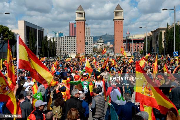 Protesters wave Spanish flags during a demonstration called by Spanish farright party Vox against the Catalan independence push in Barcelona on March...