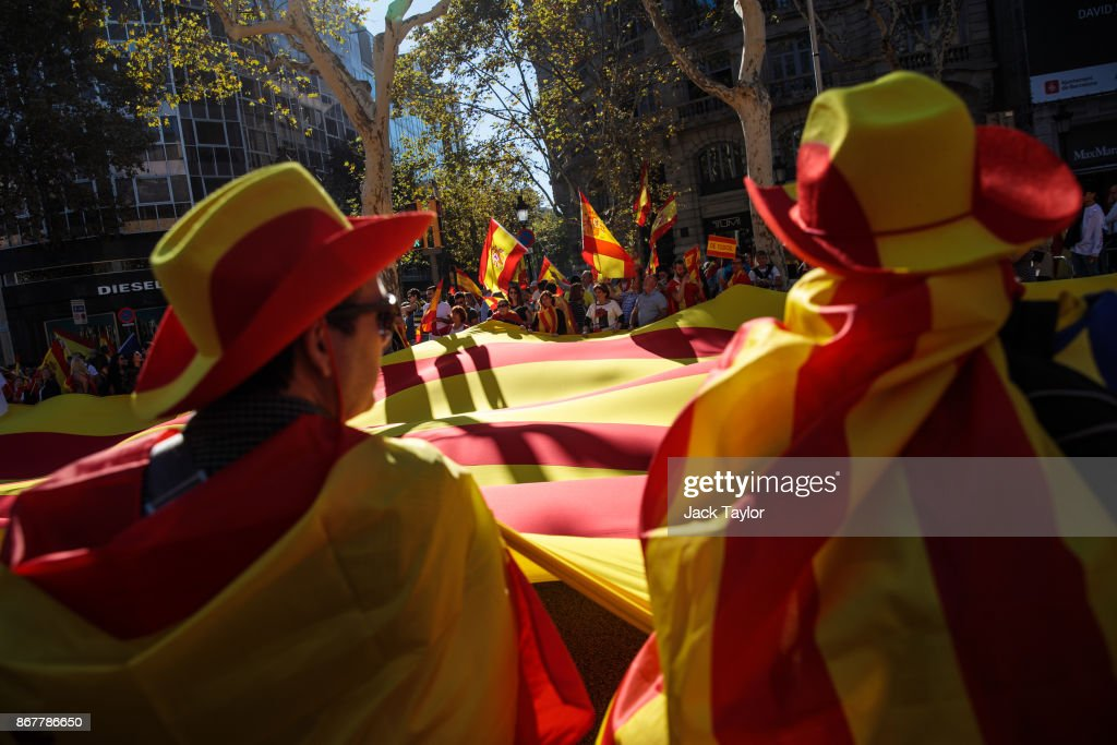 Protesters wave Spanish flags during a pro-unity demonstration on October 29, 2017 in Barcelona, Spain. Thousands of pro-unity protesters gather in Barcelona, two days after the Catalan Parliament voted to split from Spain. The Spanish government has responded by imposing direct rule and dissolving the Catalan parliament.